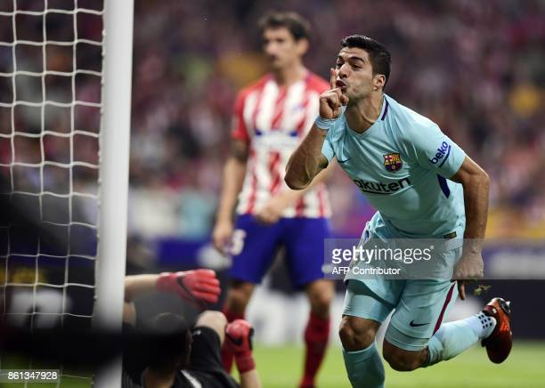 Barcelona's Uruguayan forward Luis Suarez celebrates a goal during the Spanish league football match Club Atletico de Madrid vs FC Barcelona at the...