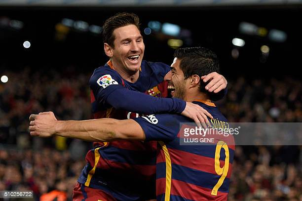 TOPSHOT Barcelona's Uruguayan forward Luis Suarez celebrates a goal with Barcelona's Argentinian forward Lionel Messi during the Spanish league...
