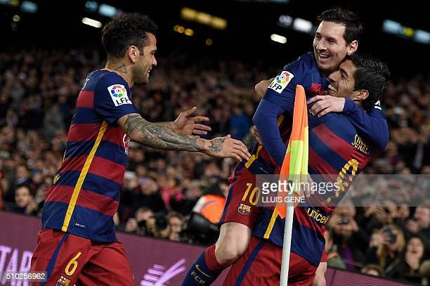 Barcelona's Uruguayan forward Luis Suarez celebrates a goal with Barcelona's Argentinian forward Lionel Messi and Barcelona's Brazilian defender Dani...