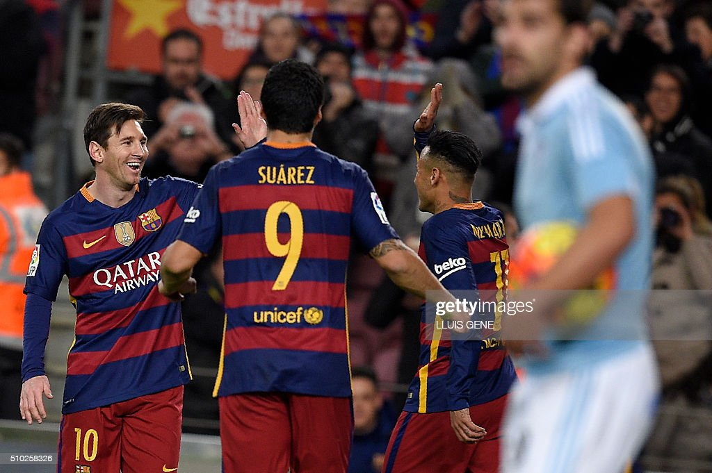 Barcelona's Uruguayan forward Luis Suarez (C) celebrates a goal with Barcelona's Brazilian forward Neymar (R) and Barcelona's Argentinian forward Lionel Messi during the Spanish league football match FC Barcelona vs RC Celta de Vigo at the Camp Nou stadium in Barcelona on February 14, 2016. GENE