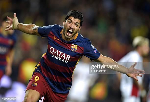 Barcelona's Uruguayan forward Luis Suarez celebrates after scoring a goal during the UEFA Champions League football match FC Barcelona vs Bayer...