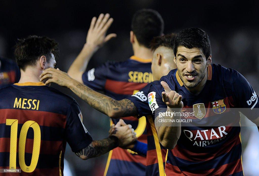 TOPSHOT Barcelona's Uruguayan forward Luis Suarez celebrates after scoring a goal during the Spanish league football match Real Betis Balompie vs FC...
