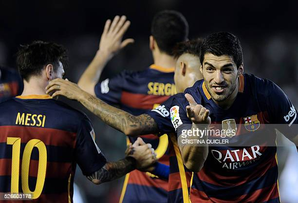 TOPSHOT Barcelona's Uruguayan forward Luis Suarez celebrates after scoring a goal during the Spanish league football match Real Betis Balompie vs FC...