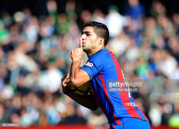 TOPSHOT Barcelona's Uruguayan forward Luis Suarez celebrates after scoring a goal during the Spanish league football match Real Betis vs FC Barcelona...