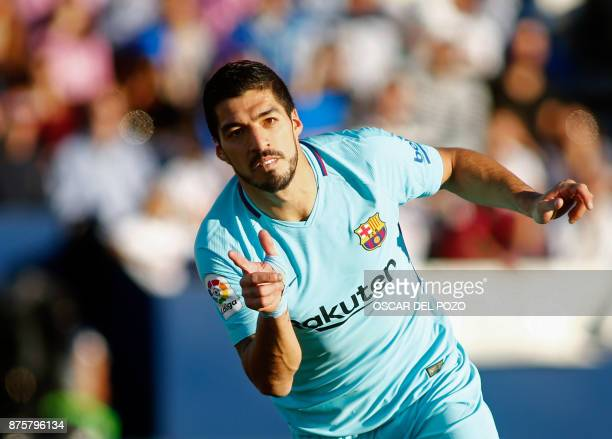 Barcelona's Uruguayan forward Luis Suarez celebrates after scoring a goal during the Spanish league football match Leganes vs Barcelona at the...