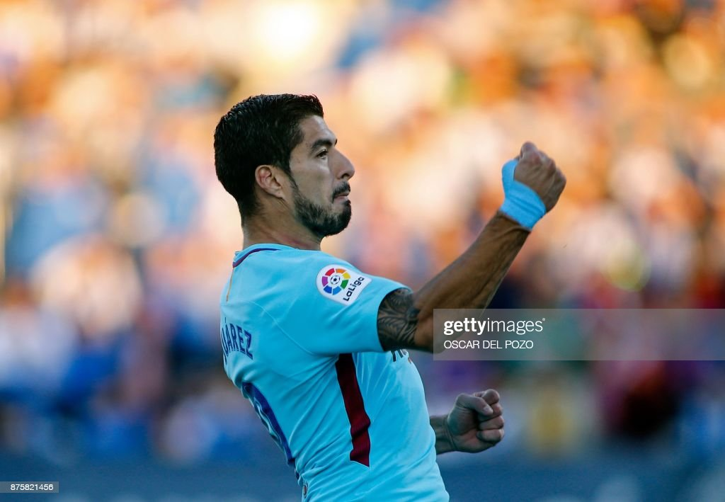 Barcelona's Uruguayan forward Luis Suarez celebrates after scoring a goal during the Spanish league football match Leganes vs Barcelona at the Butarque stadium in Leganes on November 18, 2017. /