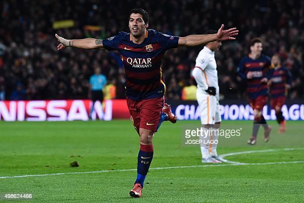 Barcelona's Uruguayan forward Luis Suarez celebrates after scoring during the UEFA Champions League Group E football match FC Barcelona vs AS Roma at...