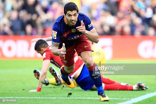 Barcelona's Uruguayan forward Luis Suarez celebrates after scoring during the Spanish league football match FC Barcelona vs Club Atletico de Madrid...