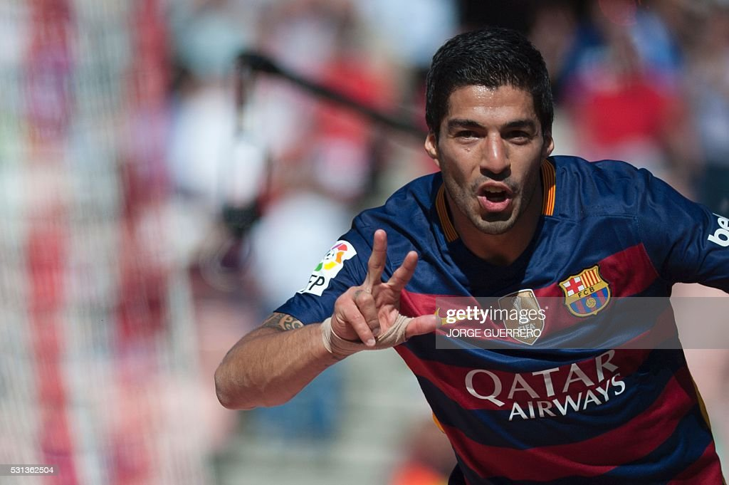 TOPSHOT Barcelona's Uruguayan forward Luis Suarez celebrates after scoring during the Spanish league football match Granada CF vs FC Barcelona at...