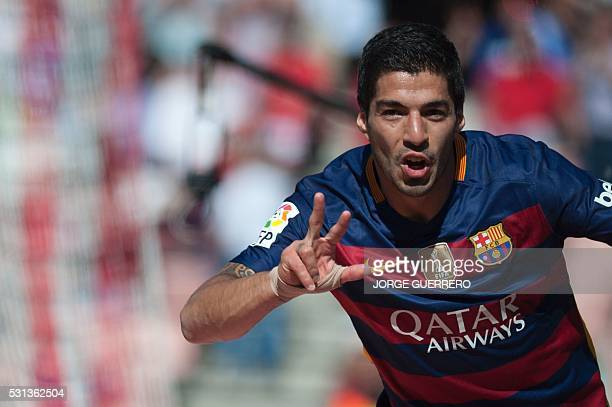 TOPSHOT Barcelona's Uruguayan forward Luis Suarez celebrates after scoring during the Spanish league football match Granada CF vs FC Barcelona at...