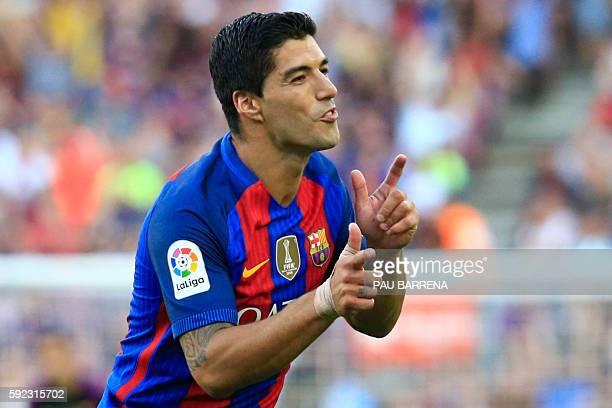Barcelona's Uruguayan forward Luis Suarez celebrates after scoring during the Spanish league football match FC Barcelona vs Real Betis Balompie at...