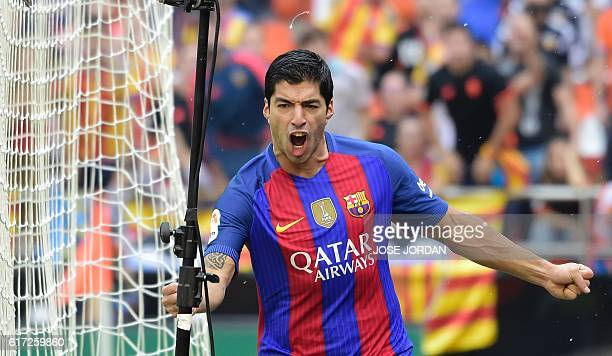 Barcelona's Uruguayan forward Luis Suarez celebrates after scoring during the Spanish league football match Valencia CF vs FC Barcelona at the...