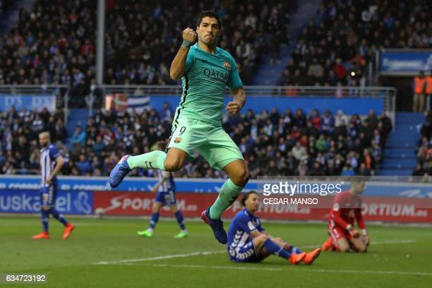 Barcelona's Uruguayan forward Luis Suarez celebrates after scoring during the Spanish league football match Deportivo Alaves vs FC Barcelona at the...