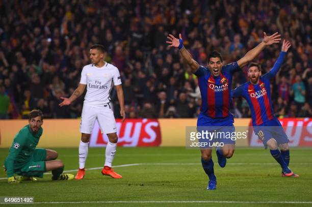 Barcelona's Uruguayan forward Luis Suarez celebrates after scoring the opener during the UEFA Champions League round of 16 second leg football match...
