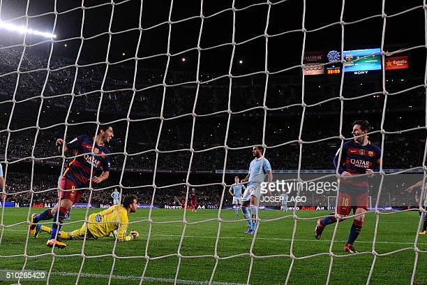 Barcelona's Uruguayan forward Luis Suarez celebrates his goal after a penalty kick with Barcelona's Argentinian forward Lionel Messi during the...