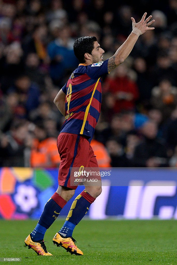 Barcelona's Uruguayan forward Luis Suarez celebrates his goal during the Spanish league football match FC Barcelona vs RC Celta de Vigo at the Camp Nou stadium in Barcelona on February 14, 2016. LAGO