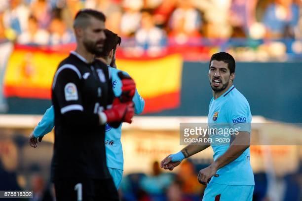 Barcelona's Uruguayan forward Luis Suarez celebrates near Leganes' Spanish goalkeeper Pichu Cuellar after scoring a goal during the Spanish league...