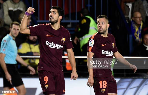 Barcelona's Uruguayan forward Luis Suarez celebrates next to Barcelona's Spanish defender Jordi Alba after scoring during the Spanish league football...