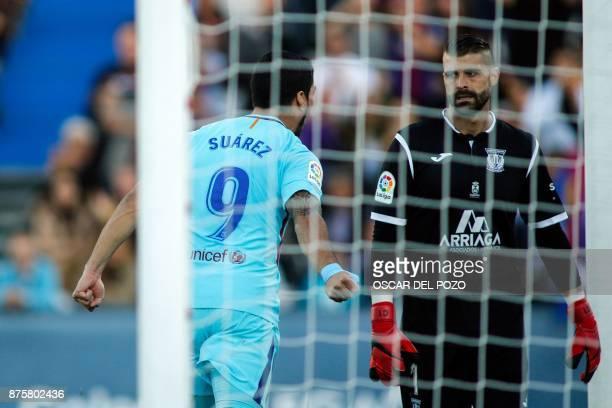 Barcelona's Uruguayan forward Luis Suarez celebrates past Leganes' Spanish goalkeeper Pichu Cuellar after scoring a goal during the Spanish league...