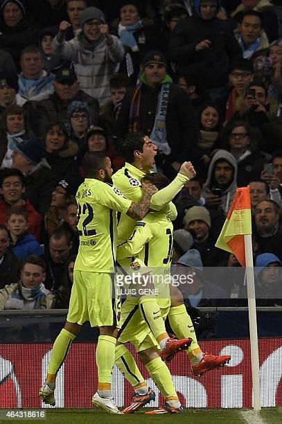Barcelona's Uruguayan forward Luis Suarez celebrates scoring the opening goal with Barcelona's Brazilian defender Dani Alves and Barcelona's...