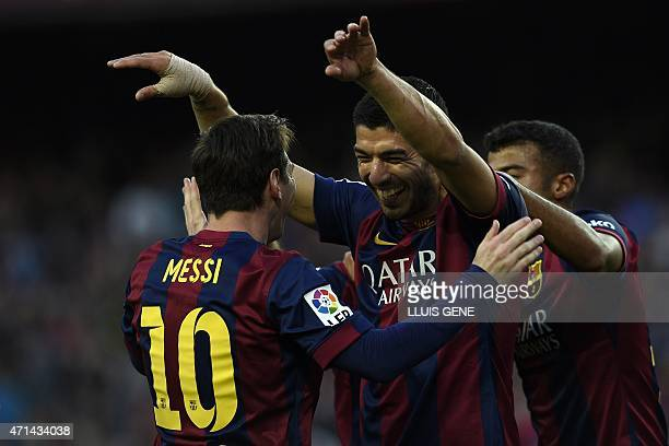 Barcelona's Uruguayan forward Luis Suarez celebrates with Barcelona's Argentinian forward Lionel Messi after scoring a goal during the Spanish league...