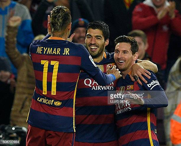 Barcelona's Uruguayan forward Luis Suarez celebrates with Barcelona's Brazilian forward Neymar and Barcelona's Argentinian forward Lionel Messi after...