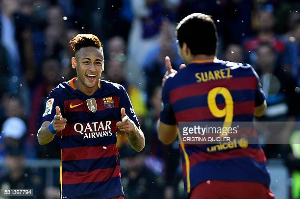 Barcelona's Uruguayan forward Luis Suarez celebrates with Barcelona's Brazilian forward Neymar after scoring during the Spanish league football match...