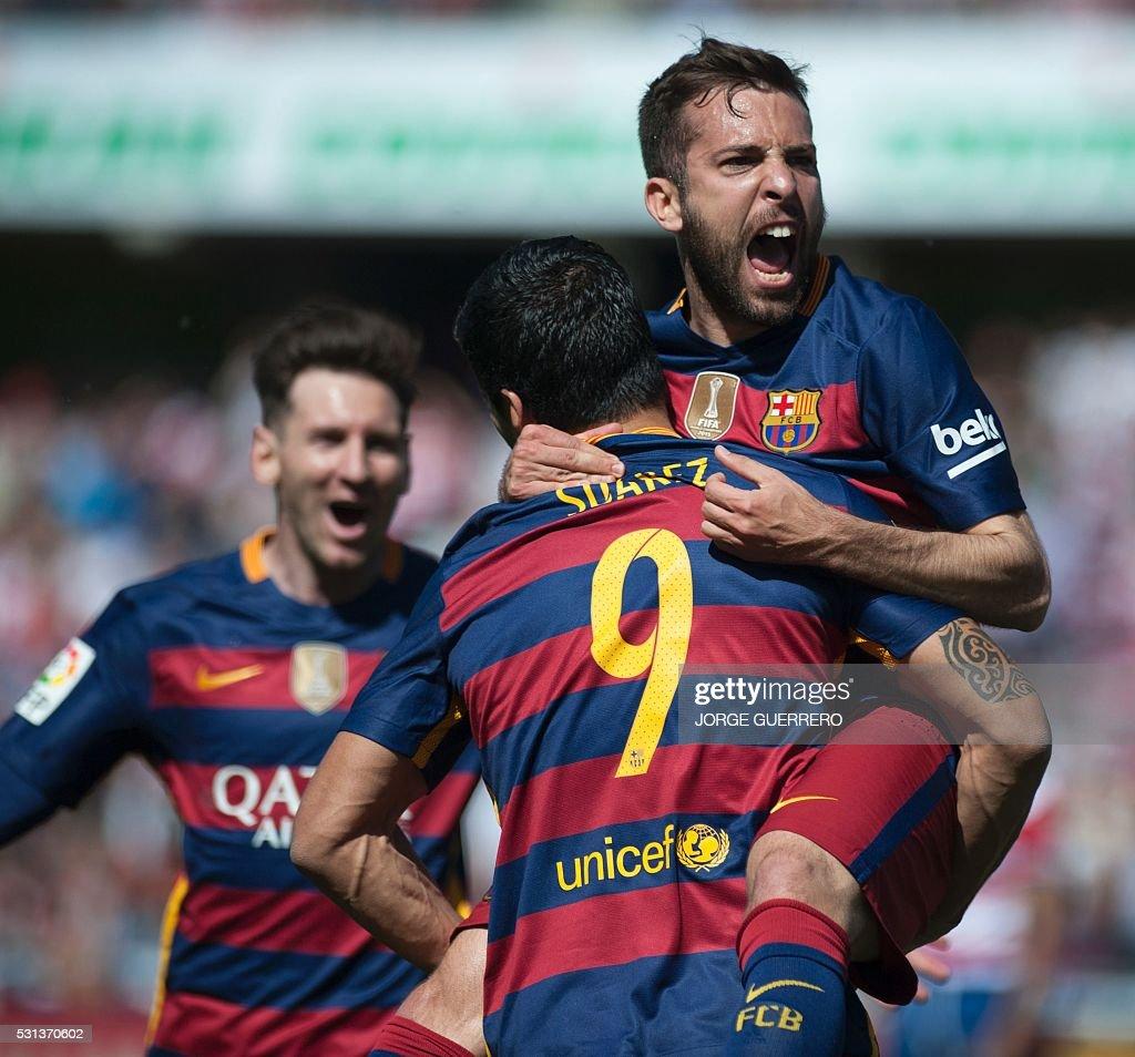 Barcelona's Uruguayan forward Luis Suarez celebrates with Barcelona's defender Jordi Alba and Barcelona's Argentinian forward Lionel Messi after...
