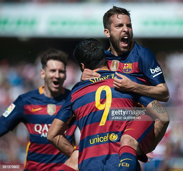 Barcelona's Uruguayan forward Luis Suarez celebrates with Barcelona's defender Jordi Alba and Barcelona's Argentinian forward Lionel Messi after...
