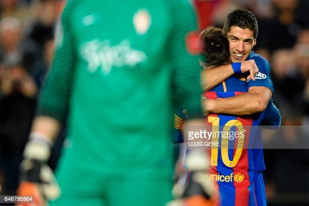TOPSHOT Barcelona's Uruguayan forward Luis Suarez celebrates with Barcelona's Argentinian forward Lionel Messi after scoring during the Spanish...
