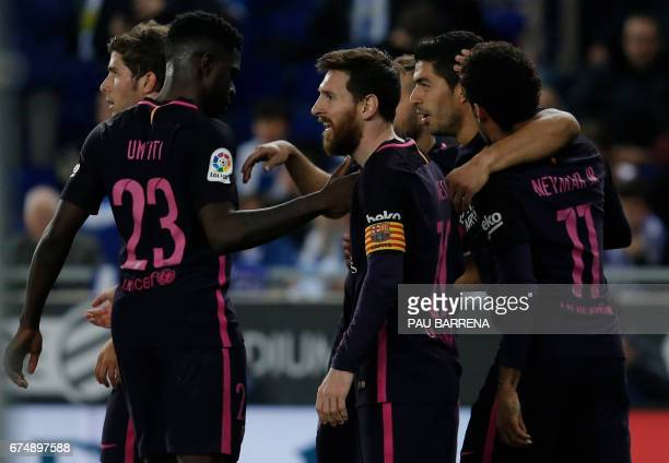 TOPSHOT Barcelona's Uruguayan forward Luis Suarez celebrates with Barcelona's Argentinian forward Lionel Messi and teammates after scoring his team's...