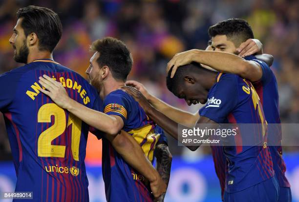 Barcelona's Uruguayan forward Luis Suarez celebrates with Barcelona's French forward Ousmane Dembele Barcelona's Argentinian forward Lionel Messi and...