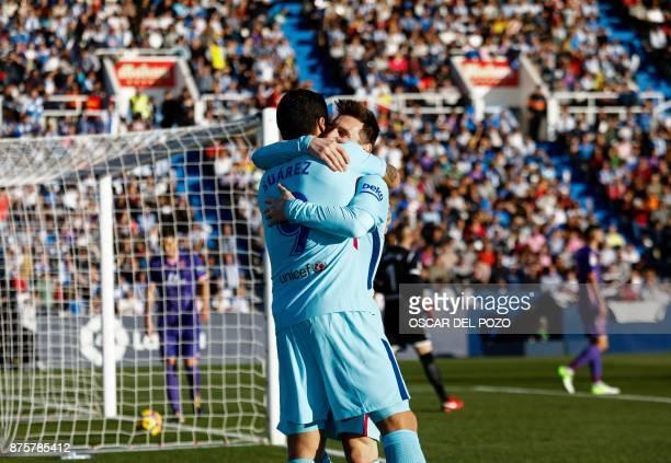 Barcelona's Uruguayan forward Luis Suarez celebrates with Barcelona's Argentinian forward Lionel Messi after scoring a goal during the Spanish league...