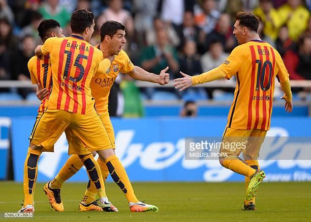 Barcelona's Uruguayan forward Luis Suarez celebrates with teammates after scoring a goal during the Spanish league football match RC Deportivo de la...