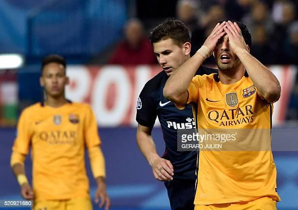 TOPSHOT Barcelona's Uruguayan forward Luis Suarez gestures after missing a goal during the Champions League quarterfinal second leg football match...