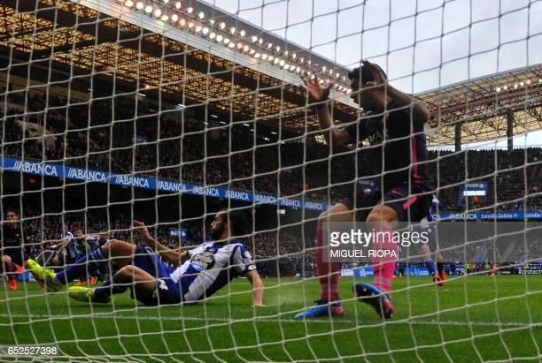 Barcelona's Uruguayan forward Luis Suarez gestures after missing a goal during the Spanish league footbal match RC Deportivo de la Coruna vs FC...