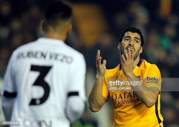 Barcelona's Uruguayan forward Luis Suarez gestures after missing an attempt on goal during the Spanish league football match Valencia CF vs FC...