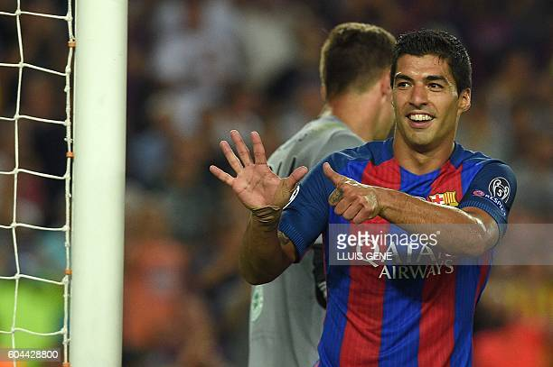 Barcelona's Uruguayan forward Luis Suarez gestures after scoring a goal during the UEFA Champions League football match FC Barcelona vs Celtic FC at...