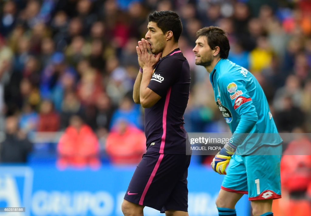 Barcelona's Uruguayan forward Luis Suarez (L) gestures beside Deportivo La Coruna's Argentinian goalkeeper German Dario Lux after missing a goal during the Spanish league footbal match RC Deportivo de la Coruna vs FC Barcelona at the Municipal de Riazor stadium in La Coruna on March 12, 2017. /