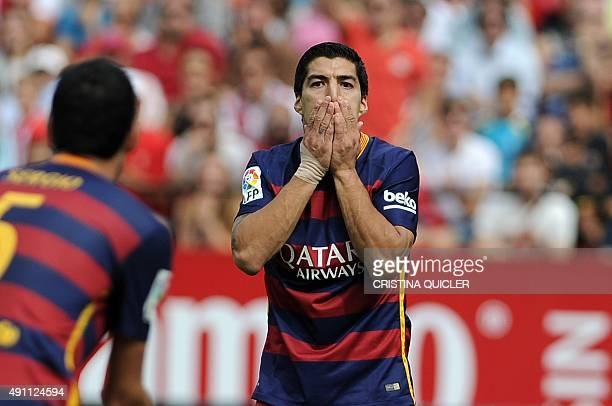 Barcelona's Uruguayan forward Luis Suarez gestures during the Spanish league football match Sevilla FC vs Barcelona at the Ramon Sanchez Pizjuan...