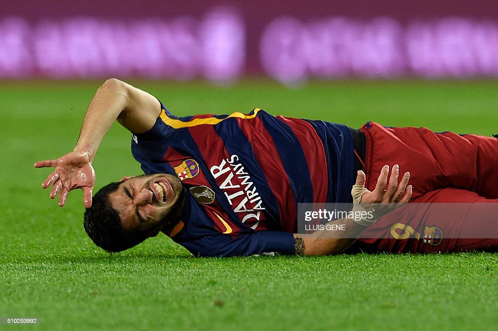 Barcelona's Uruguayan forward Luis Suarez gestures on the field during the Spanish league football match FC Barcelona vs RC Celta de Vigo at the Camp Nou stadium in Barcelona on February 14, 2016. GENE