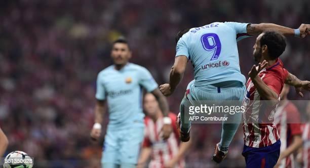 Barcelona's Uruguayan forward Luis Suarez heads the ball to score a goal during the Spanish league football match Club Atletico de Madrid vs FC...