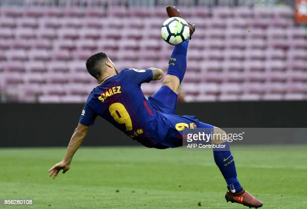 TOPSHOT Barcelona's Uruguayan forward Luis Suarez kicks the ball during the Spanish league football match FC Barcelona vs UD Las Palmas at the Camp...