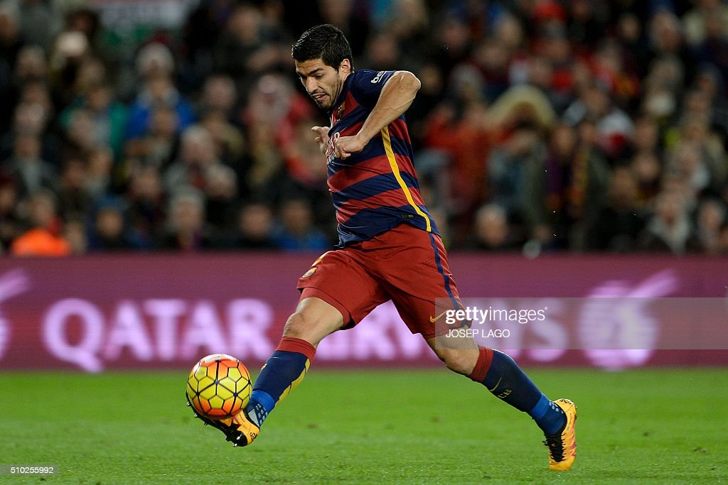 Barcelona's Uruguayan forward Luis Suarez kicks the ball to score a goal during the Spanish league football match FC Barcelona vs RC Celta de Vigo at the Camp Nou stadium in Barcelona on February 14, 2016. LAGO