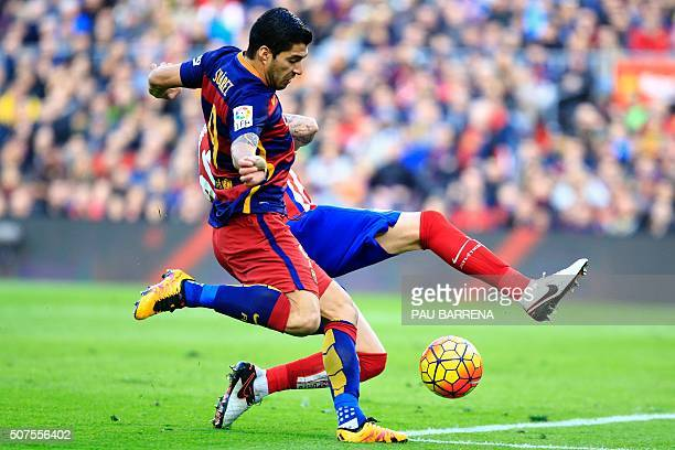 TOPSHOT Barcelona's Uruguayan forward Luis Suarez kicks the ball to score during the Spanish league football match FC Barcelona vs Club Atletico de...