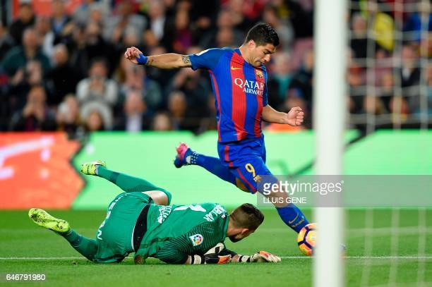 TOPSHOT Barcelona's Uruguayan forward Luis Suarez kicks to score during the Spanish league football match FC Barcelona vs Real Sporting de Gijon at...