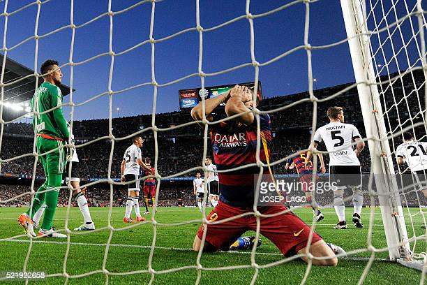 Barcelona's Uruguayan forward Luis Suarez kneels in the goal during the Spanish league football match FC Barcelona vs Valencia CF at the Camp Nou...