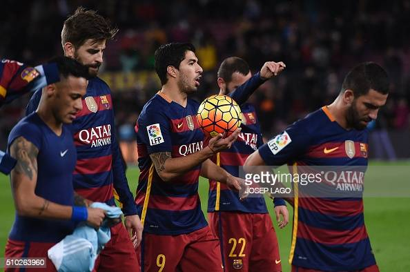 Barcelona's Uruguayan forward Luis Suarez leaves the pitch after doing it a hattrick with teammates Barcelona's Brazilian forward Neymar Barcelona's...