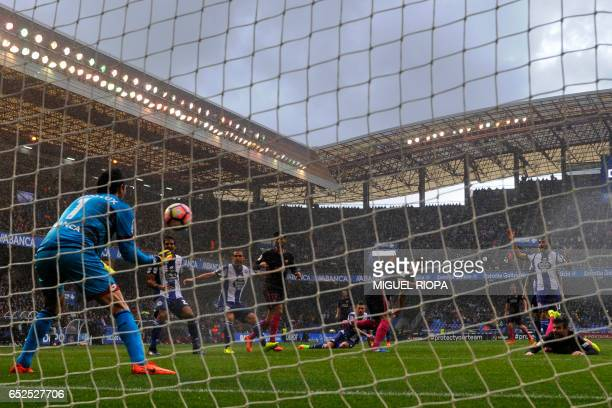 Barcelona's Uruguayan forward Luis Suarez misses a goal during the Spanish league footbal match RC Deportivo de la Coruna vs FC Barcelona at the...