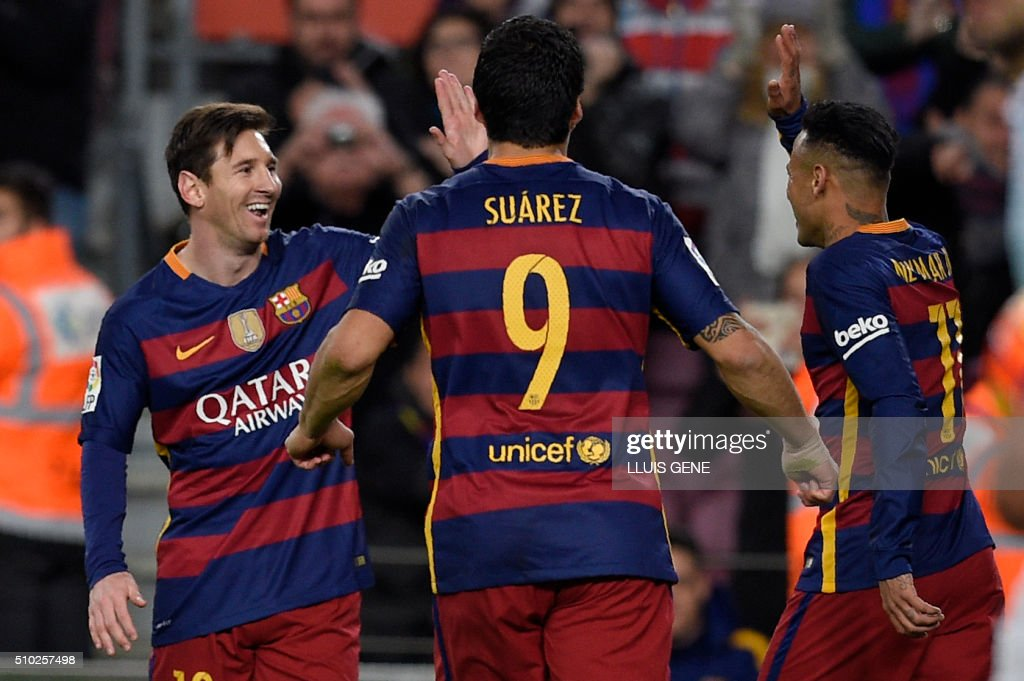 Barcelona's Uruguayan forward Luis Suarez (C) runs to celebrate a goal with Barcelona's Brazilian forward Neymar (R) and Barcelona's Argentinian forward Lionel Messi during the Spanish league football match FC Barcelona vs RC Celta de Vigo at the Camp Nou stadium in Barcelona on February 14, 2016. GENE